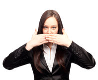 Young woman covering her mouth with both hands Royalty Free Stock Photography
