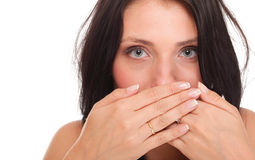 Young woman covering her mouth both hands isolated Royalty Free Stock Photography