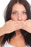 Young woman covering her mouth both hands isolated Stock Photography