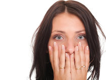 Young woman covering her mouth both hands isolated Royalty Free Stock Image