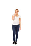 Young woman covering her mouth with hand.  Stock Photography
