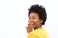 Young woman covering her mouth and laughing. Portrait of happy african woman covering her mouth and laughing against white background Stock Images