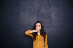 Young woman covering her mouth Royalty Free Stock Photos