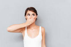 Young woman covering her mouth with palm Stock Image