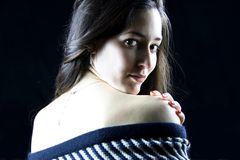 Young woman covering her naked body with wool cape royalty free stock images
