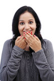 Young woman covering mouth with her hands Royalty Free Stock Image