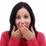 Young woman covering mouth with her hands Stock Photos