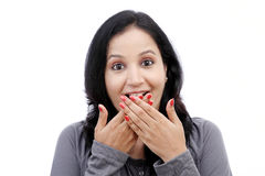 Young woman covering mouth with her hands Royalty Free Stock Photography