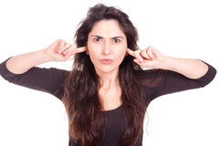 Young woman covers her ears Royalty Free Stock Photography