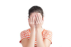 Young woman covers her face with hands Royalty Free Stock Photo