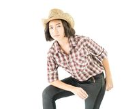 Young woman in a cowboy hat and plaid shirt Stock Photo