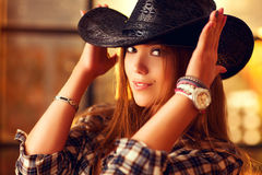 Young woman cowboy Stock Photos