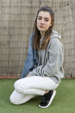 Young woman with a cowgirl jacket over shoulder with serious fac Royalty Free Stock Image