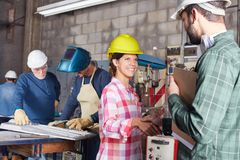 Young woman in craftsman apprenticeship. Young women in craftsman apprenticeship welcomes artisan stock photography