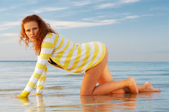 Young woman crawling Royalty Free Stock Image