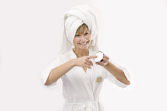 Young woman with a cream box Stock Photography