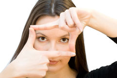 Young woman creates a frame with her hands. Royalty Free Stock Photo