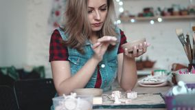 Young woman creates a plate of clay in the workshop. girl holding a shape of clay in her hands. the creative hobby.  stock video