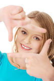 Young woman creating frame with fingers Royalty Free Stock Photos