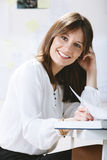 Young woman creative designer working in office. Royalty Free Stock Images