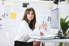 Young woman creative designer working in office. Royalty Free Stock Photo