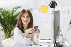 Young woman creative designer working in office. Royalty Free Stock Image