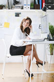 Young woman creative designer working in office. royalty free stock photography