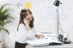 Young woman creative designer working in office. Stock Photography