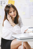 Young woman creative designer working in office. stock photo