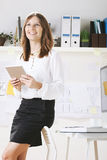 Young woman creative designer working in office with digital tablet. Royalty Free Stock Images