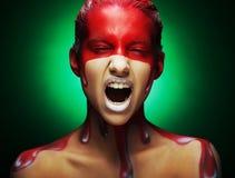 Creative face-art, youmg woman close up. Young woman with creative face-art stock photo