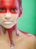 Young woman with creative face-art Stock Photos
