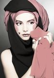 Young woman with creative make-up. In black and red turban Stock Photo