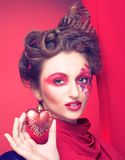 Young woman with creative make-up. With red and pink hearts Stock Photography