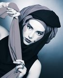 Young woman with creative make-up. In black and red turban Royalty Free Stock Images