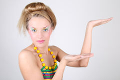Young woman with creative make-up and coiffure Stock Photos