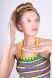 Young woman with creative make-up and coiffure Stock Images