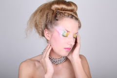 Young woman with creative make-up and coiffure Royalty Free Stock Image