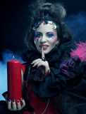 Young woman with creative make up. Halloween theme. Royalty Free Stock Photo