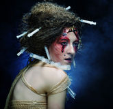 Young woman with creative make up. Halloween theme. Royalty Free Stock Image