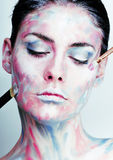 Young woman with creative make up like painted oil picture on fa Royalty Free Stock Photo
