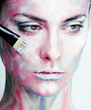Young woman with creative make up like painted oil Royalty Free Stock Photos