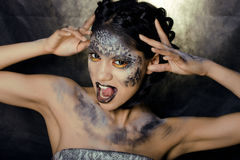 young woman with creative make up like a snake Stock Photos