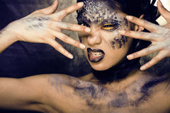 Young woman with creative make up like a snake Stock Images