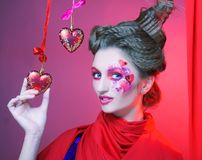 Young woman with creative make-up. With red and pink hearts Royalty Free Stock Images