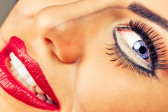 Young woman with creative makeup. Against gray background Stock Image