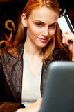 Young woman with credit card. And laptop Stock Photos