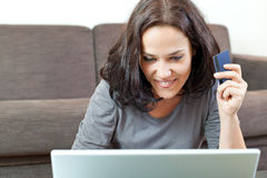Young woman with credit card Stock Images