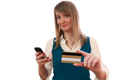 Young woman with credit card and cellphone Stock Image