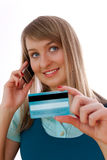 Young woman with credit card and cellphone Royalty Free Stock Photography